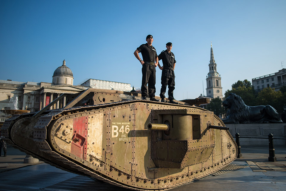 A British First World War tank displayed in Trafalgar Square with members of the Royal Tank Regiment.